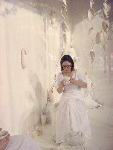 """Initial performance of Tea Ceremony in Dreamscapes Installation """"Tea for Two"""" - first performance occurred between two friends, second between mother and daughter │ Jenkins Music Co storefront, Kansas City, MO │ Commissioned by Charlotte Street Foundation"""
