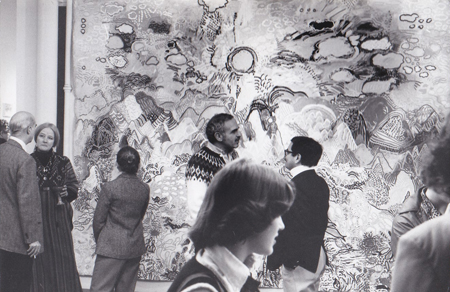 image of an art opening with people and a large painting filling the background