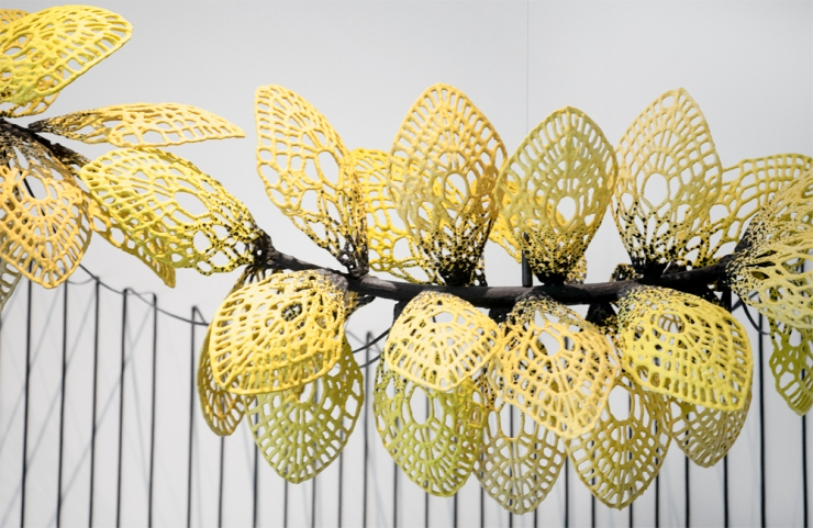 detail of suspended and wall-mounted sculpture consisting of clusters of lace petals
