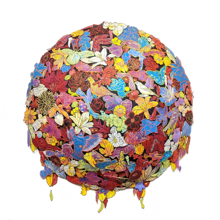 A multi-colored domed and round textile artwork, consisting of many individual wool applique elements.